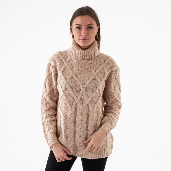 Image of   Cable knit high neck sweater