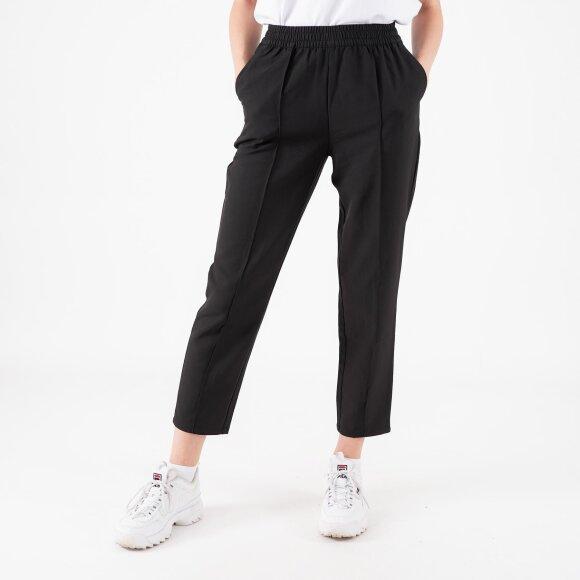 Elastic waist seamline pants fra na-kd fra kingsqueens.dk